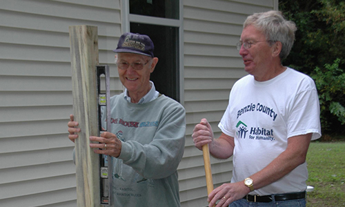 Habitat For Humanity volunteers working on a new home for a deserving family